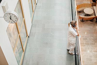 Female doctor on the phone - p312m2174380 by Scandinav