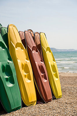 Kayaks on weymouth beach - p9244166f by Image Source