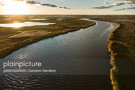 USA, Maryland, Drone view of marsh along Blackwater River at sunset - p300m2220525 by Cameron Davidson