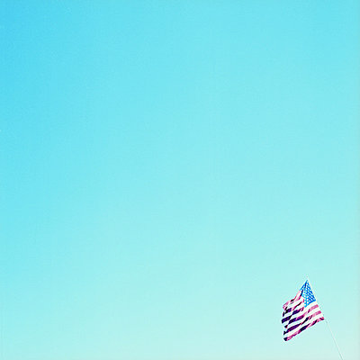 US flag against blue sky - p9240284 by Takahiro Igarashi