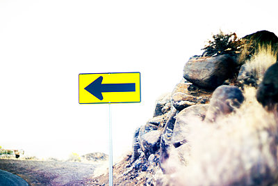 Directional Sign at Edge of Road - p694m2218870 by Justin Hill photography