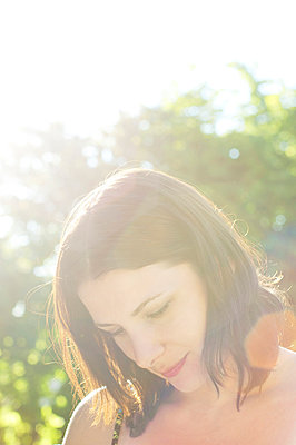 Attractive young woman in afternoon sunlight  - p1072m829418 by Neville Mountford-Hoare