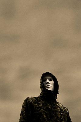 Man wearing white mask  - p597m971201 by Tim Robinson