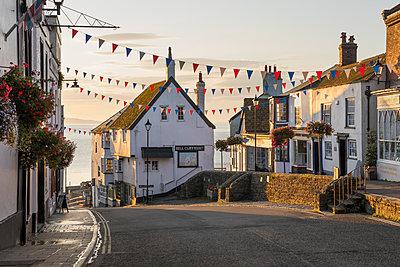 View along Broad Street at sunrise, Lyme Regis, Dorset, England, United Kingdom, Europe - p871m1519277 by Stuart Black