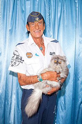 Man with persian cat - p978m658389 by Petra Herbert