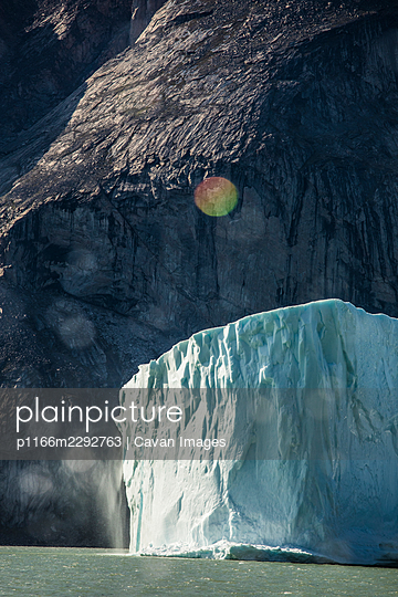 Scenic view of meting glacier against raw mountain cliff. - p1166m2292763 by Cavan Images