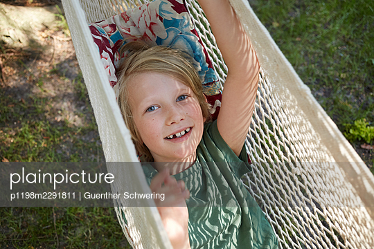 Child in a hammock - p1198m2291811 by Guenther Schwering