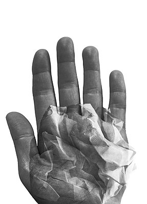 Double exposure of a hand and a crumpled ball of paper - p1682m2264035 by Régine Heintz