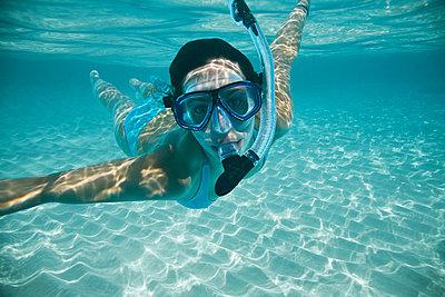 Woman Snorkeling - p4295392 by Hugh Whitaker