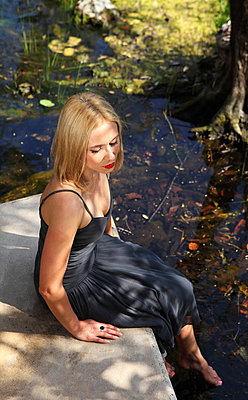 Woman by a pond - p045m813525 by Jasmin Sander