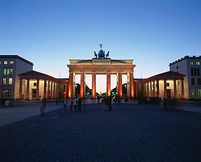 Brandenburg Gate illuminated with orange light - p3013701f by Lothar Schulz