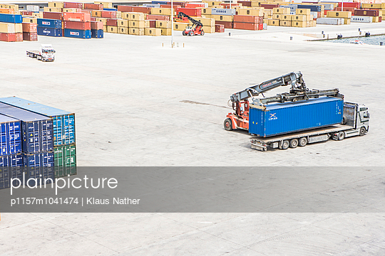 Truck in container harbor - p1157m1041474 by Klaus Nather