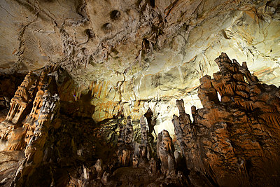Low angle view of rock formations in cave - p1166m1532300 by Cavan Social