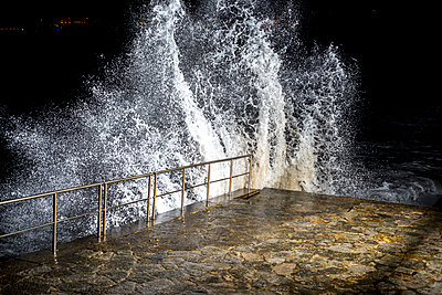 Night time waves lit with strobe lighting - p1201m1463389 by Paul Abbitt