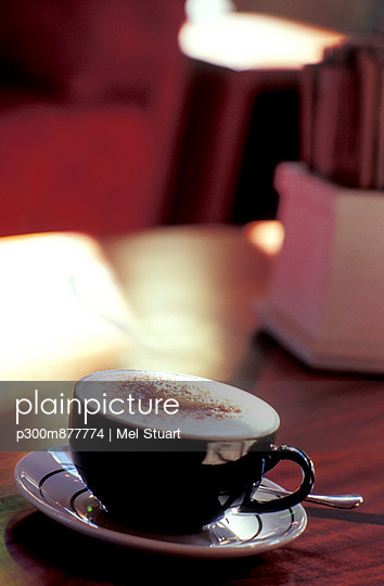 Coffee cup on table with foam