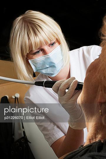 Dentist with dental drill