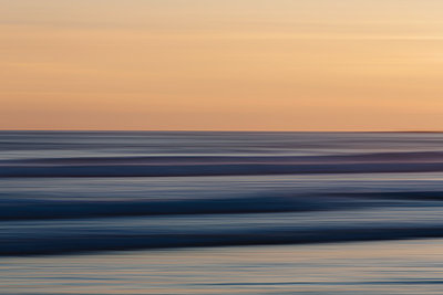 View from the beach over the ocean at sunset, long exposure - p1100m1216310 by Mint Images