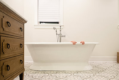 Cropped hands of girl in bathtub at home - p1166m2000663 by Cavan Images