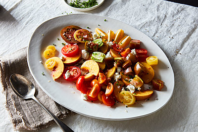 tomato peach chevre and herb salad - p1379m1525433 by James Ransom