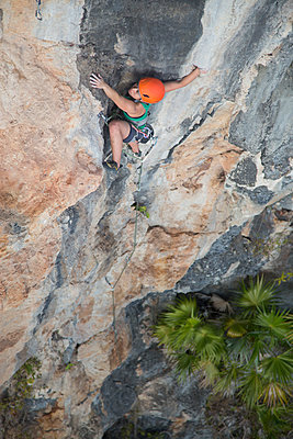 High angle view of female hiker rock climbing - p1166m1521820 by Cavan Images