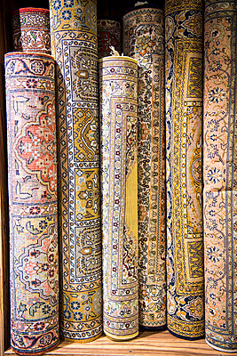 Middle East, Oman, Muscat.  Persian carpets for sale at a shop in the old Muttrah Souk - p652m1576195 by John Warburton-Lee