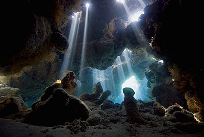 Sunlight coming into underwater cave, Red Sea, Egypt - p884m1145355 by Dray van Beeck/ NiS