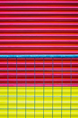 Red and yellow garage door - p1228m1225890 by Benjamin Harte