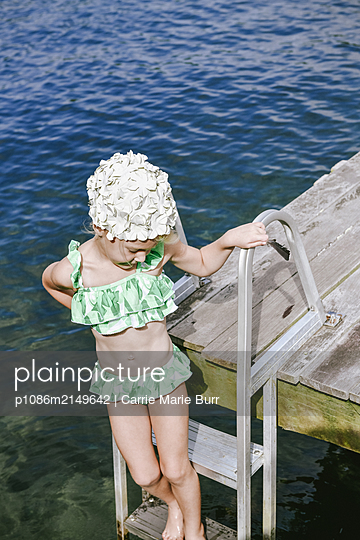 Little girl at the lake - p1086m2149642 by Carrie Marie Burr