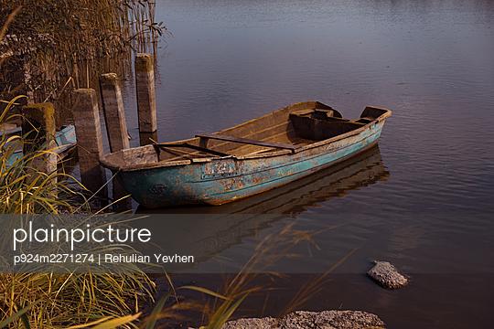 Ukraine, Old wooden boat moored on lake - p924m2271274 by Rehulian Yevhen