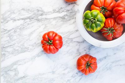 Marinda tomatoes in bol on marble plate - p300m940960f by Larissa Veronesi