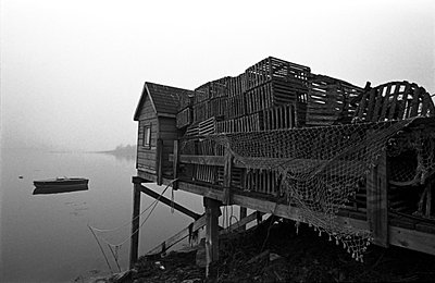 Pile of Lobster Crates Behind Shack on Dock, Maine, USA - p694m720353 by Bill Koechling