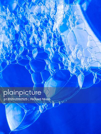 Bubbles inside a clear blue bottle - p1302m2092525 by Richard Nixon