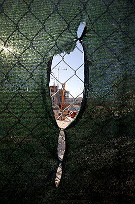 Construction site seen through fence - p3882040 by L.B.Jeffries