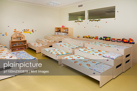 Day care nursery or pre-school kindergarten bedrooms for nap time, pull out bunks - p1100m2300879 by Mint Images
