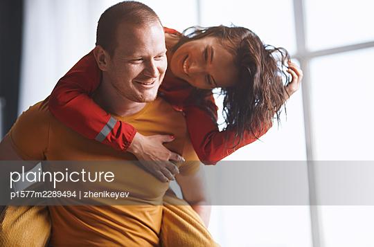 Redhead man and Asian woman having fun - p1577m2289494 by zhenikeyev