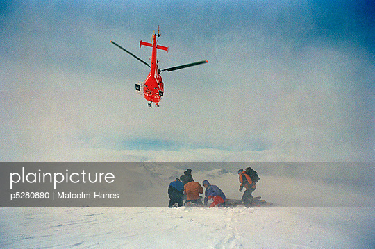A rescue helicopter landing on a mountain Riksgransen Sweden. - p5280890 by Malcolm Hanes