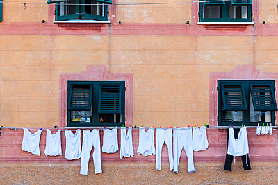 Laundry on clothesline at house - p300m884920f by Martin Moxter