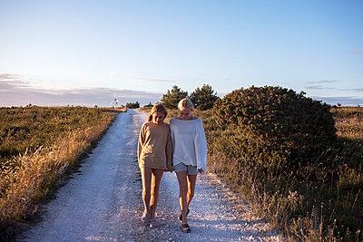 Teenage girls walking - p312m1470962 by Christina Strehlow