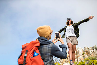 Young couple mountain hiking - p1355m1574159 by Tomasrodriguez