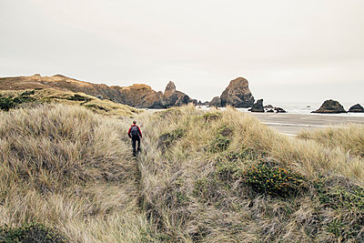 Man Hiking Remote Beach, Oregon Coast, Pacific Northwest - p1262m1072145 by Maryanne Gobble