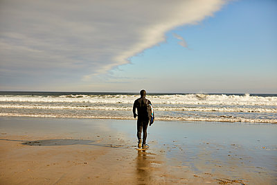 A Surfer Walking Toward Sea At Good Harbor Beach In Gloucester, Ma - p343m1443992 by Josh Campbell