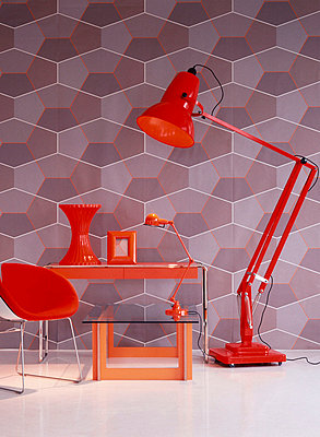 Retro wallpapered room with red furniture home wares and lighting - p349m695178 by Emma Lee