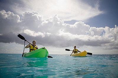 Two Women Kayaking - p4295383 by Hugh Whitaker