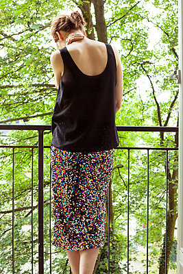 Woman on a balcony - p432m912021 by mia takahara