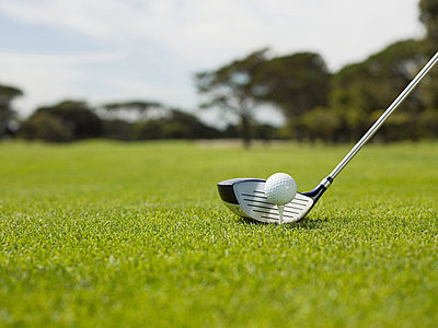 Golf ball on golf course, close up - p9244378f by Image Source