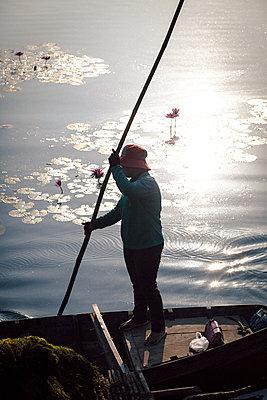 Fishermen at sunrise in Angkow Wat - p795m2223233 by JanJasperKlein