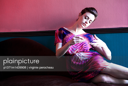 Woman in the sofa - p1371m1439908 by virginie perocheau