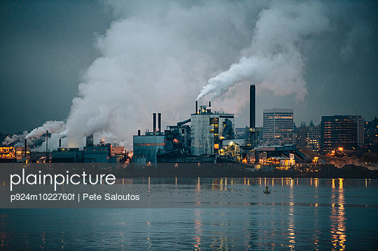 View of industrial plant and smoke stacks at night, Tacoma, Washington, USA - p924m1022760f by Pete Saloutos