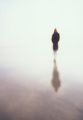 Woman reflected in wet sand on beach - p1427m2254878 by Chris Hackett