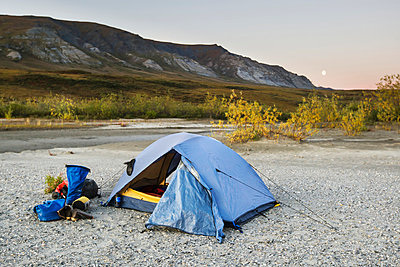 A tent set up with a view of the brooks range gates of the arctic national park northwestern alaska;Alaska united states of america - p442m837583f by Scott Dickerson